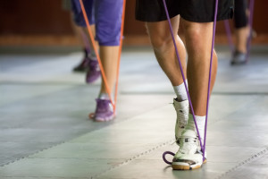 muscular legs with a resistance band